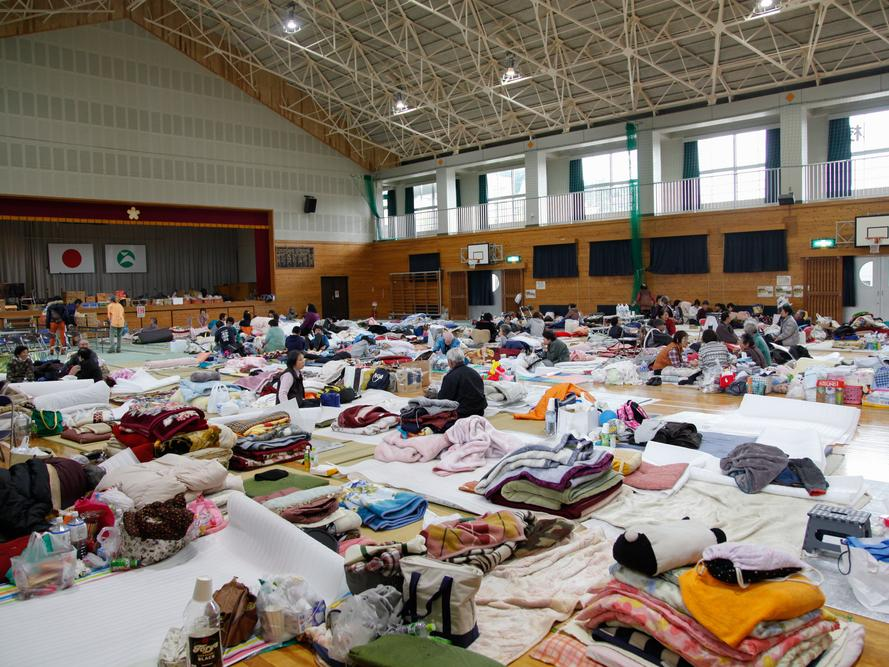people gathered in an emergency shelter