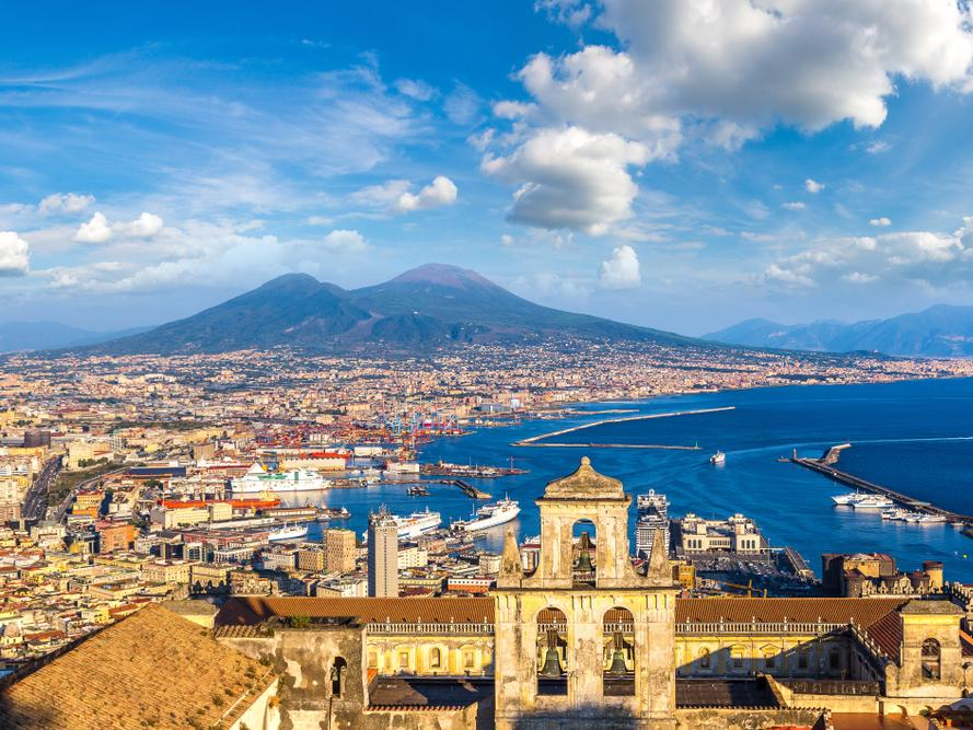 Naples and mount Vesuvius in the background at sunset in a summer day, Italy, Campania