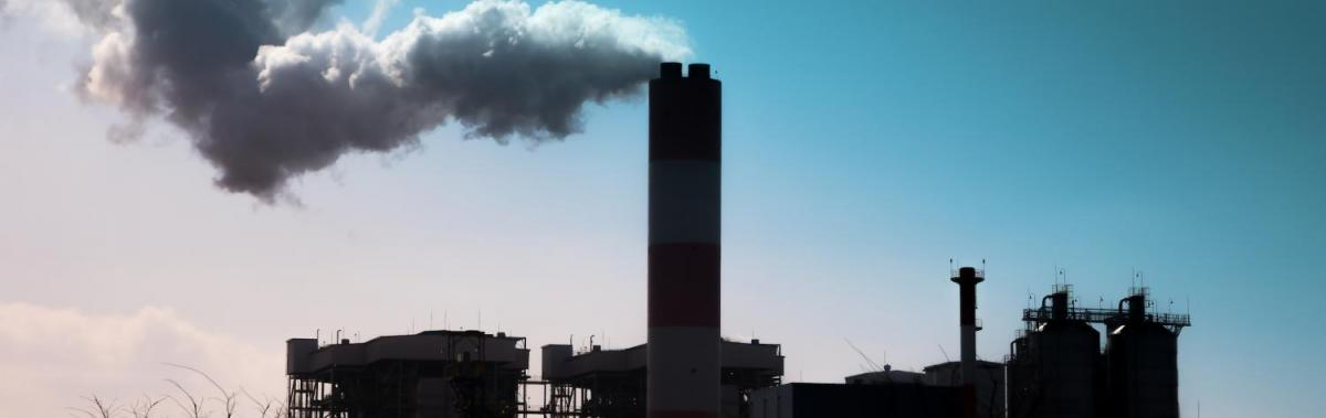 Smoke blows from factory chimneys